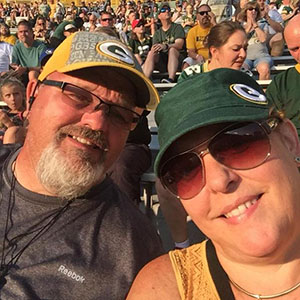 Wes and Brenda enjoying the Packer game