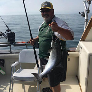 Wes enjoying charter fishing on Lake Michigan